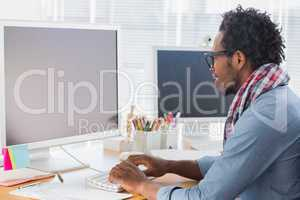 Creative business worker on computer