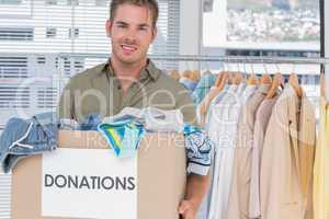 Handsome man holding donation box