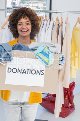 Young volunteer holding clothes donation box