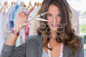 Attractive designer holding scissors
