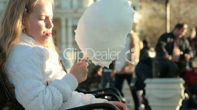 Urban scene - girl eating cotton candy