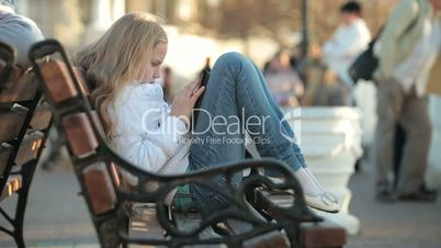 Urban Scene - Child Using Touch Screen Tablet PC