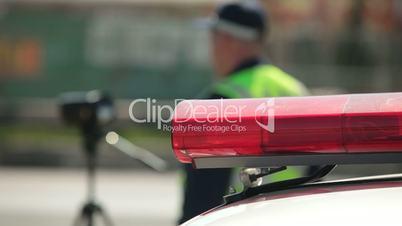 Police Officer Using Radar Speed Gun