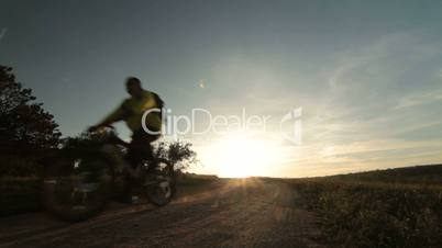 Cross-country cycling at sunrise