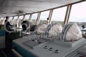 navigational officer driving ship on the river.