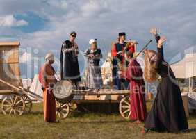folk musicians and woman dancer.
