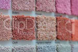 carpet samples in shades of red, orange and pink