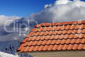 roof tiles against winter mountains