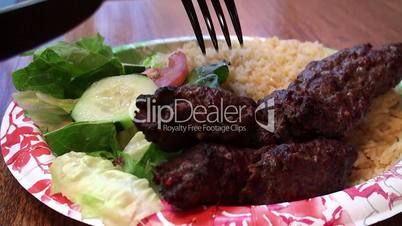 Arabic fast food (kabobs with rice & vegetables)