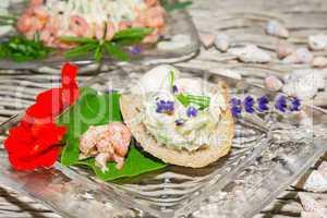 Herb butter and prawns with nasturtium