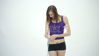HD1080 Slim brunette girl measuring her belly and is happy. Version 1