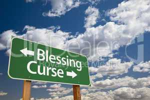 Blessing Curse Green Road Sign and Clouds