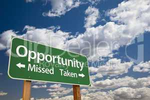 Opportunity Missed and Taken Green Road Sign with Clouds