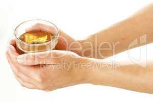 Woman hands holding a glass of tea