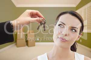 Young Woman Being Handed Keys in Empty Room with Boxes