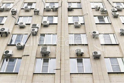 mani air conditioners on the building wall