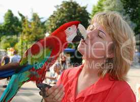 woman with red macaw