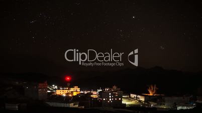 Star sky over the mountain village in  Himalayas.