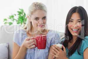 Blonde woman smiling at camera with friend