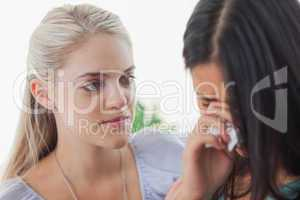 Blonde listening to her tearful friend