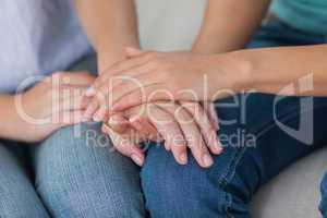 Close friends touching hands