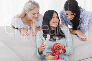 Woman looking thankful for present from her friends