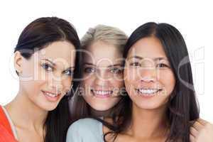 Diverse young women smiling at camera