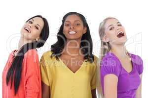 Diverse young women laughing at camera