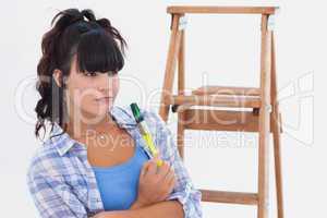 Woman holding paintbrush