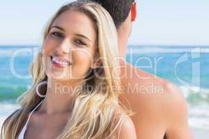 Blonde smiling and leaning against her boyfriend