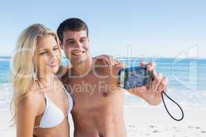 Man taking self portrait of him and pretty girlfriend