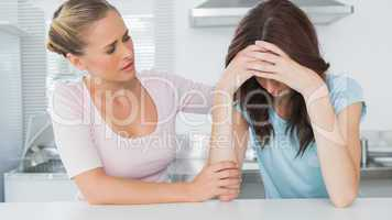 Woman comforting her upset friend
