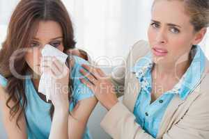 Therapist with her patient crying looking at camera