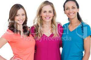 Happy models posing with colorful t shirts