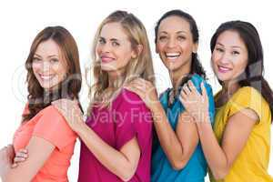 Cheerful models in a line posing with colorful t shirts