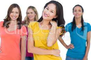 Natural models posing with elegant brunette on foreground touchi