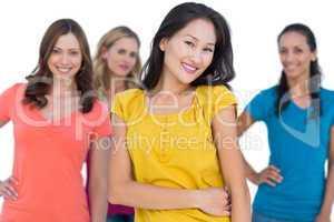 Natural models posing with elegant brunette on foreground hands