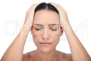 Young woman having strong headache