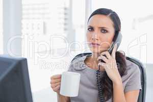 Worried secretary answering phone