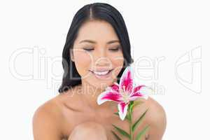 Cheerful natural black haired model posing with lily