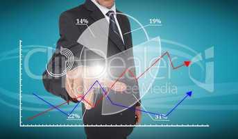 Businessman touching futuristic pie chart interface