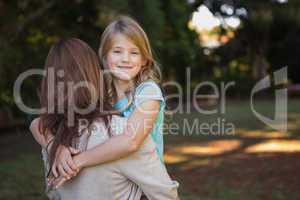 Child looking over her mothers shoulder