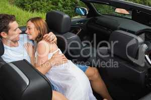 Couple in love relaxing in the backseat