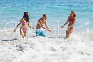 Cheerful friends playing in the sea