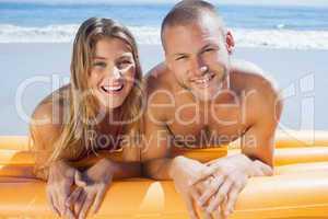 Happy cute couple in swimsuit posing