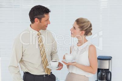 Stylish workmates having coffee together