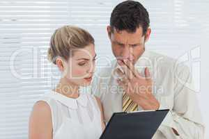 Concentrated coworkers analyzing documents together