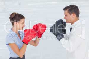 Colleagues in competition having a boxing match