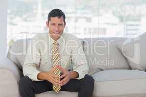 Self-confident businessman sitting on sofa