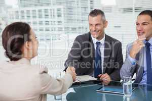 Brown haired woman shaking hands with her future employer